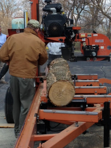 Prof. Dan Cassens conducts a sawmill demo.